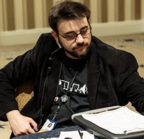 A photograph of Dominic Cerquetti while overseeing MAGFest